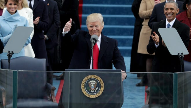 President Donald Trump gives a thumbs up after his inauguration on the West Front of the U.S. Capitol on Friday.