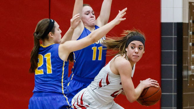Sussex Hamilton senior Taylor Laboy (22) looks for help when cornered by Germantown's Amber Ische (21) and Natalie McNeal (11) at Hamilton on Tuesday, Jan. 30, 2018.