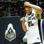 A.J. Hammons pauses briefly to collect his thoughts before speaking on senior night following Purdue's 91-80 victory over Wisconsin Sunday, March 6, 2016, at Mackey Arena.