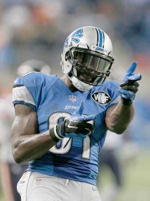 Detroit Lions receiver Calvin Johnson celebrates his 57-yard reception to set up the Lions game-winning field goal in overtime on Sunday, October 18, 2015, in Detroit.