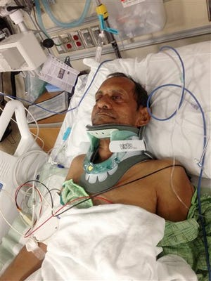 In this Saturday, photo released by Chirag Patel,  Sureshbhai Patel is shown in a bed at Huntsville Hospital in Huntsville, Ala. An officer with the Madison Police Department has been arrested and faces termination following a confrontation in which the 57-year-old Indian grandfather was injured.