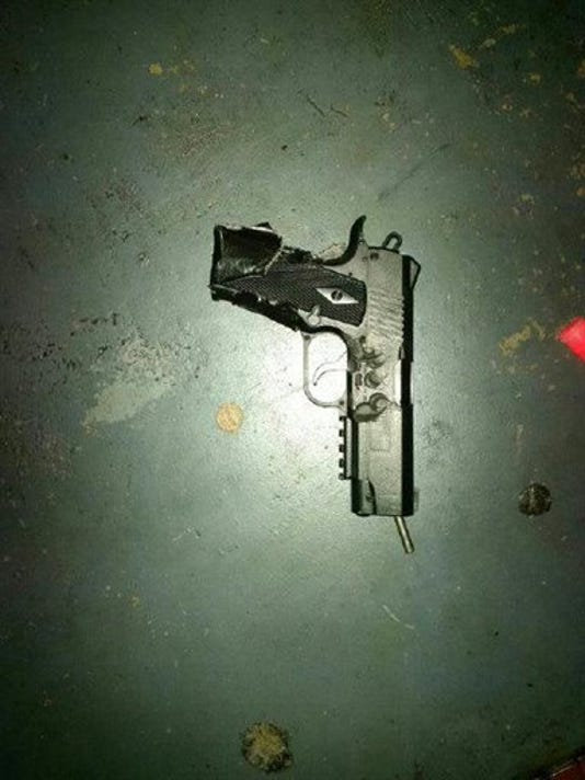 This photo released by the Metro Nashville Police Department shows a pellet gun carried by an attacker at a movie theater in Antioch, Tenn., Wednesday, Aug. 5, 2015.