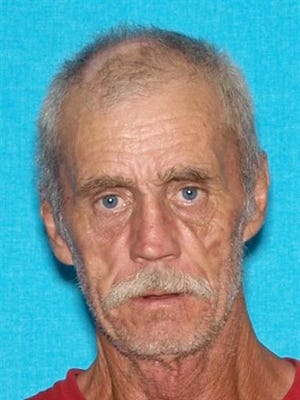 Floyd Ray Cook is seen in an undated photo provided by the Kentucky State Police. A manhunt is underway for Cook, who is accused of shooting and wounding a Tennessee police officer and then firing at a state trooper in Kentucky. Classes were called off Monday in Cumberland County as the manhunt continued. (Kentucky State Police via AP)