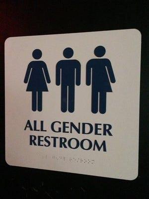 "An ""All Gender Restroom"" sign marks a bathroom in a bar in Washington."