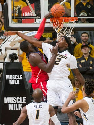 Missouri's Willie Jackson, right, fouls Arizona's Rawle Alkins, left, as he tries to dunk the ball during the first half of an NCAA college basketball game Saturday, Dec. 10, 2016, in Columbia, Mo.
