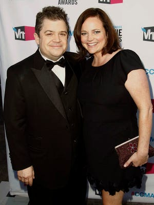 FILE - In this Jan. 12, 2012 file photo, Patton Oswalt, left, and his wife Michelle Eileen McNamara arrive at the 17th Annual Critics' Choice Movie Awards in Los Angeles. Oswalt says coroner's officials have told him that his wife died last year from a combination of prescription medications and an undiagnosed heart condition. His statement, released by a publicist, says coroner's officials have informed him that the blockages, combined with her taking the medications Adderall, Xanax and the pain medication fentanyl, caused his wife's death in April 2016. McNamara died April 21 in her sleep at age 46.