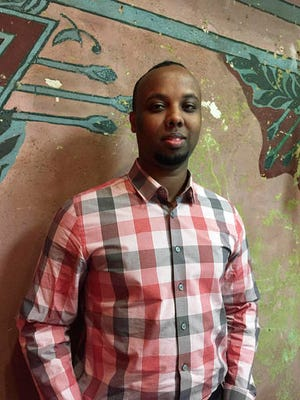 In this Feb. 14, 2017 photo, Mohamed Farah poses at his office in Minneapolis. Farah is executive director of Ka Joog, a group that works to engage Somali youth in Minnesota. The group rejected $500,000 in federal funding earlier this month, saying the actions and statements of President Donald Trump are anti-Muslim and anti-immigrant.