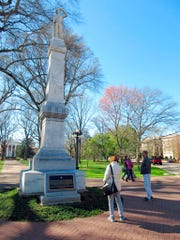 This March 12, 2017 photo shows a statue of a Confederate soldier on the campus of the University of Mississippi in Oxford, Miss. Another statue on campus honors James Meredith, an African-American student whose enrollment in 1962 sparked riots.