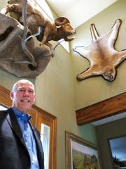 FILE - In this Oct. 5, 2016 file photo, gubernatorial candidate, Republican Greg Gianforte poses below animal trophies in his home in Bozeman, Mont. Donald Trump Jr. will be targeting more than Republican voters when the president's son campaigns for U.S. House candidate Greg Gianforte in Montana on Friday, April 21, 2017 and Saturday, leading to backlash from at least one animal-rights organization. Gianforte, who is up against Democrat Rob Quist in the May 25 election for the U.S. House seat vacated by Interior Secretary Ryan Zinke, is planning to take Trump on a prairie dog hunt during their four-city campaign tour.