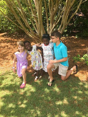 This April 15, 2017 photo provided by the family shows the four children of Josh and Laura Beth Christian in their hometown of Greenville, S.C.. From left are Emme Sue, 8; Tula, 4; Lola, 6, and Camden, 11. Tula and Lola were adopted from Uganda in 2017, although the process was delayed after the U.S. State Department shut down European Adoption Consultants, the adoption agency that the Christians had been using. The agency was accused of extensive improprieties in its operations.
