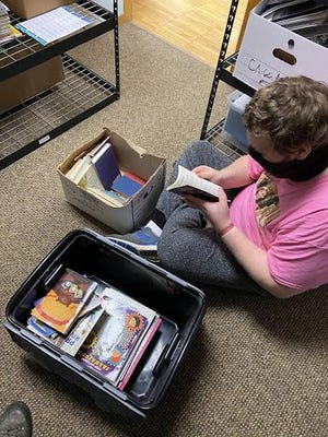 A partnership between OAISD's Young Adult Services and Help Me Grow has allowed YAS students to learn valuable life skills while providing children's books to area families.