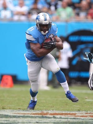Reggie Bush, shown against the Carolina Panthers Sept. 14, 2014, in Charlotte, N.C., won't play the 2014 Thanksgiving Day game in Detroit.
