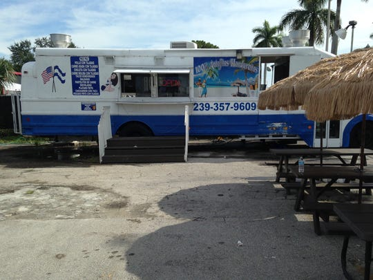 The 100% Antojitos Hondurenos food bus sits on Palm Beach Boulevard in Fort Myers.