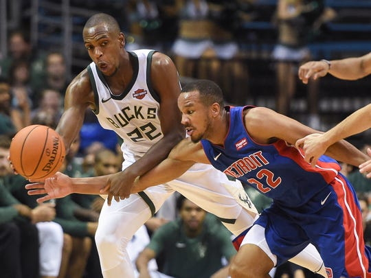 Pistons guard Avery Bradley tries to steal the ball from Bucks forward Khris Middleton.