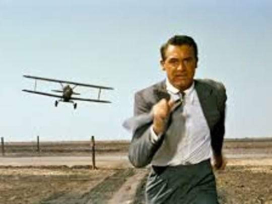 "Cary Grant is chased by a crop duster in this iconic moment from Alfred Hitchcock's ""North By Northwest"" (1959)."