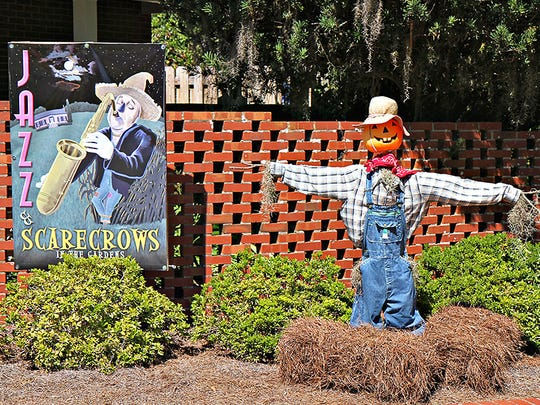 A scarecrow welcomes visitors to Maclay Gardens.