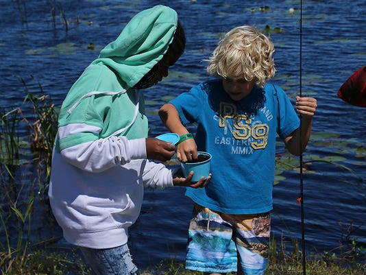 636603530486587302-Xzaveria-and-Ryvan-get-worms-during-Family-Fishing-Day-May-2017.jpg