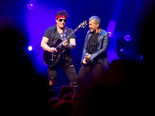 Neal Schon and Arnel Pineda of Journey perform at Thompson-Boling Arena on Wednesday, June 6, 2018.