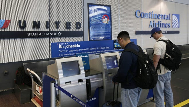Airline passengers check in at Chicago O'Hare International Airport.