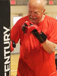 "R.J. Brockmann, 90, works out during a Marco Y ""Rock"