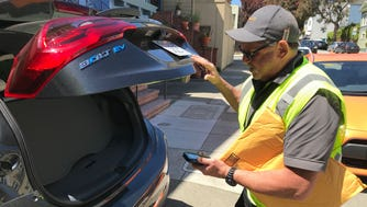 Amazon delivery person Michael Holtzen used Amazon's new in-car delivery program to deliver a package to a car in San Francisco, Calif.