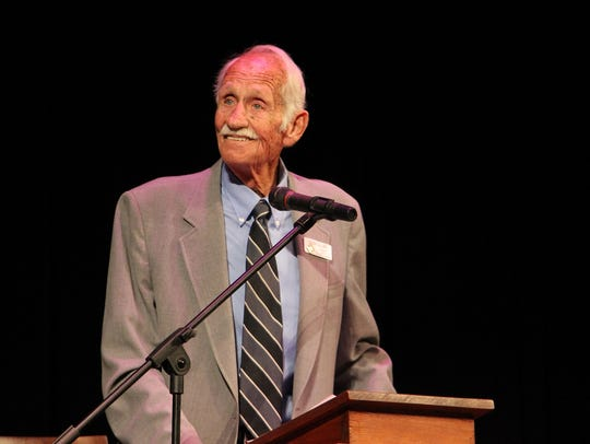 Glenn Collier debates at the Ocotillo Performing Arts