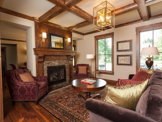 Some of the key features of the library include the fireplace and coffered ceilings.