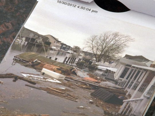 Mark Jameson displays photos that shown Superstorm