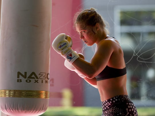 Mixed martial arts fighter Ronda Rousey works out at Glendale Fighting Club, Wednesday, July 15, 2015, in Glendale, Calif. Rousey, the UFC bantamweight champion, will return to the octagon against Brazil's unbeaten Bethe Correia at UFC 190 in Rio de Janeiro on Aug. 1. (AP Photo/Jae C. Hong)