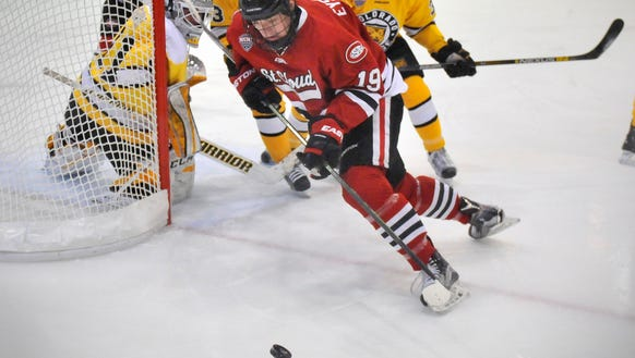St. Cloud State's Mikey Eyssimont carries the puck