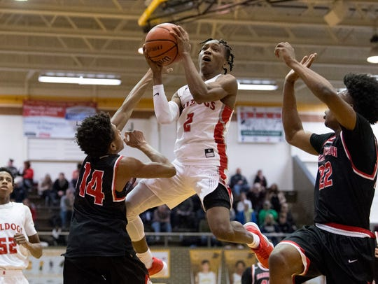 Bosse's Mekhi Lairy (2) drives to the hoop against Harrison's Kel'Ondre Dixon (14) and Isaiah Edinburgh (22) in the Bulldogs' 106-63 win in the title game of the SIAC tourney. Lairy is on the verge of setting the City's career scoring record.