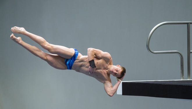 Steele Johnson competes during the USA Diving Winter National Championship's men's 10-meter platform finals, Sunday, Dec. 20, 2015, in Indianapolis. Johnson won the event with a score of 1523.05. (AP Photo/Doug McSchooler)