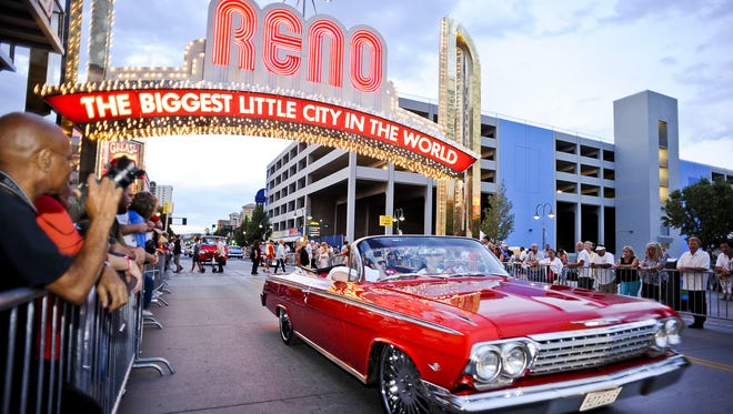 Cars pass under the Reno Arch during the Hot August Nights Cruise in 2013.