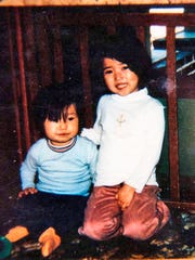This undated photo provided by Adam Crapser shows him around the age of 3 with his sister.