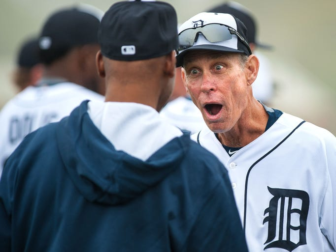 Coach Alan Trammell talks with another  coach during