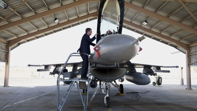 U.S. Defense Secretary Ashton Carter talks with an F-16 pilot in Jordan. Arizona may end up hosting 45 additional F-16 jets which are being moved from a Utah base to make room for new F-35 jets.
