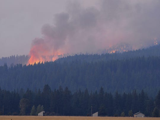 The Rice Ridge Fire burns in the Lolo National Forest near Woodworth Road northeast of Salmon Lake.