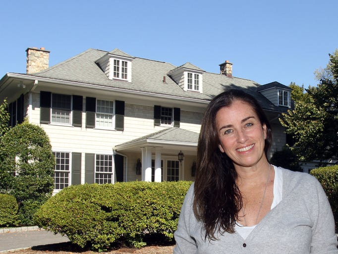 Stacey Baumer is photographed outside her Scarsdale home Oct. 1, 2013. Her home has been rented out for films and commercials. ( Frank Becerra Jr / The Journal News )