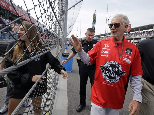 David Letterman waves to fans before the 2015 edition of the Indianapolis 500.