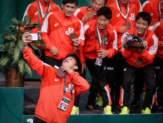 Team Japan celebrates after winning third place during