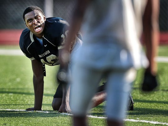Whitehaven senior Rayshad Williams calls encouragement to his team to keep the energy high during drills on Aug. 16, 2017.