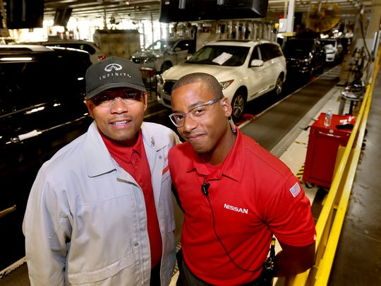 The father-son duo of Fred Lang, left, and Brandon Lang work the same shift at Nissan, which allows them to tell each other that they love each other in person every day. The two are photographed along the line at the Nissan Plant, on Tuesday, June 14, 2016.
