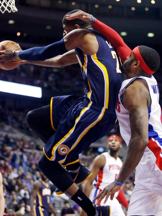 Indiana Pacers forward Paul George (24) goes to the basket past Detroit Pistons forward Josh Smith (6) during the first half of an NBA basketball game Saturday, March 15, 2014, in Detroit. (AP Photo/Duane Burleson)