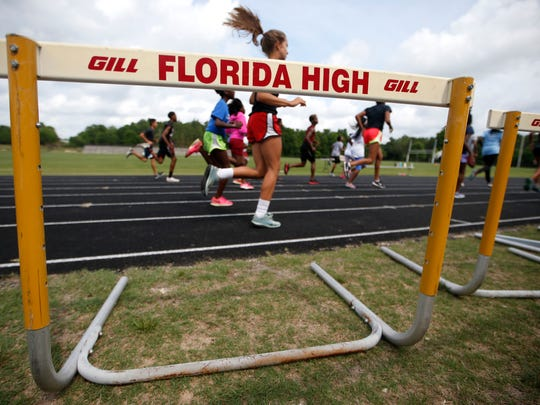 The Florida High track team takes a lap during practice at the high school on Tuesday. The team is still recovering from last year's bus crash.