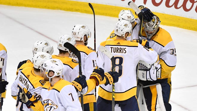 Teammates congratulate Nashville Predators goaltender Pekka Rinne (35) on the win in Game 4 in the second round NHL Stanley Cup Playoff Series at Bell MTS Place in Winnipeg, Manitoba, Canada, Thursday, May 3, 2018.