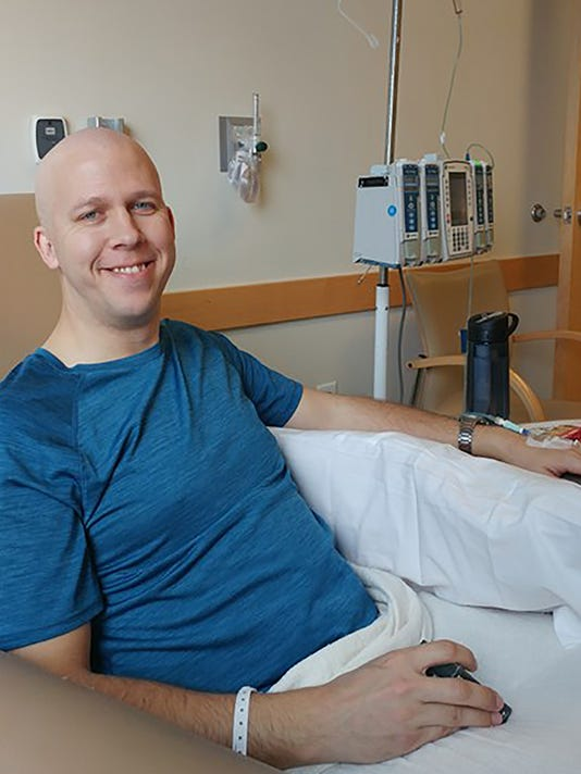 Airman undergoes cancer treatment