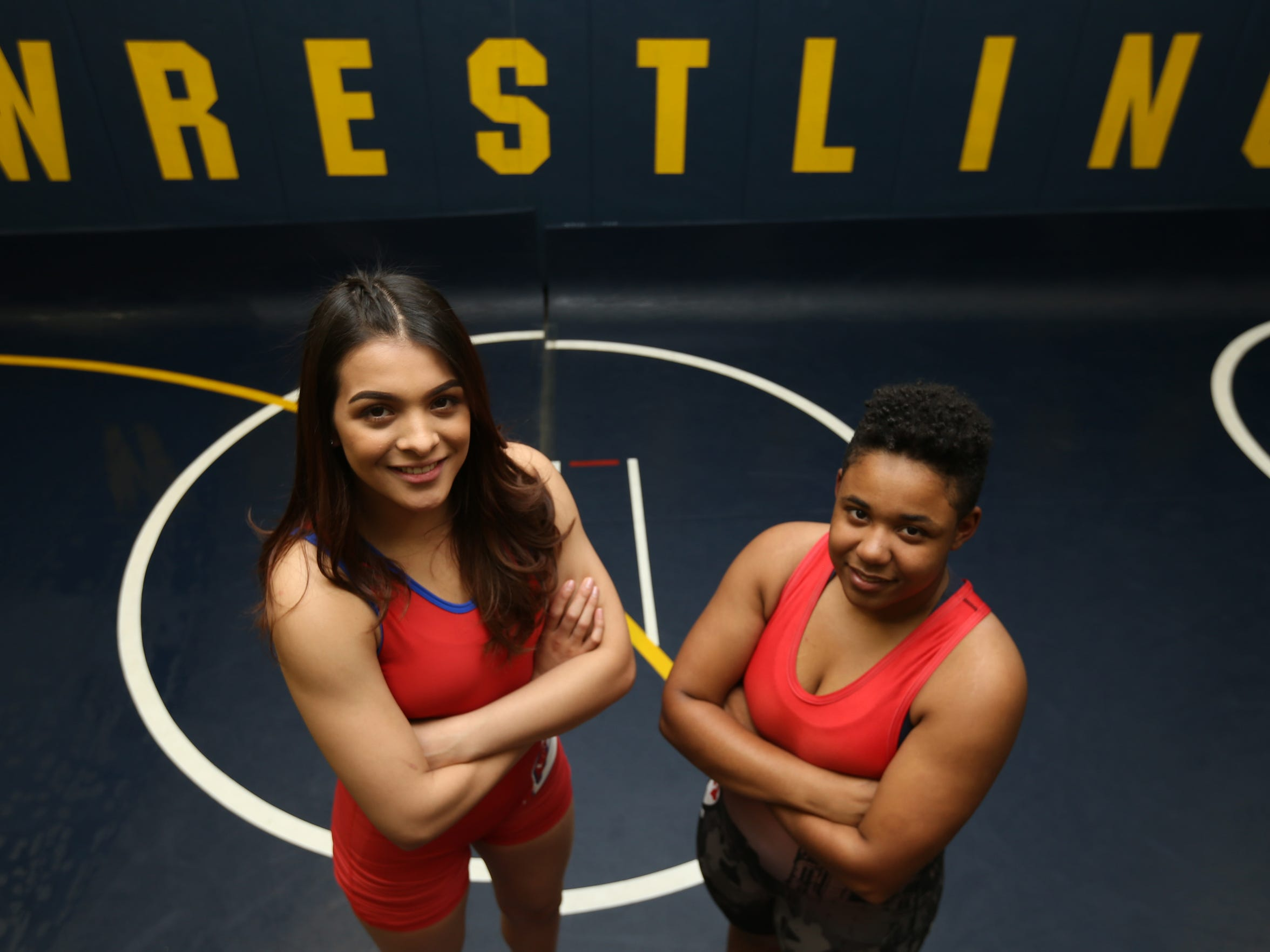 Americas' Adrienne Garcia, left, and Hanks' Gianna Morales won state wrestling titles this year. Garcia won at 128 pounds and Morales at 165.