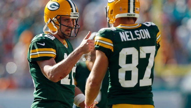 Green Bay Packers quarterback Aaron Rodgers (12) and receiver Jordy Nelson (87) celebrate a game-winning touchdown against the Miami Dolphins at Sun Life Stadium on Oct. 12, 2014.