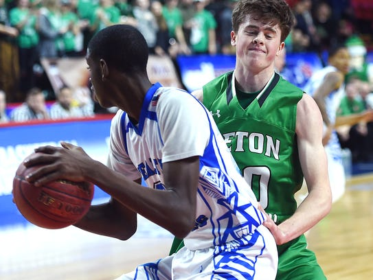 Seton Catholic Central's Leo Gallagher defends Health Sciences Charter opponent, Class B, 2018 NYSPHSAA Boys Basketball Championships, Floyd L. Maines Veterans Memorial Arena, Binghamton, March 16, 2018.
