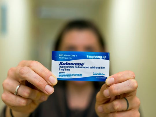 Megan Detweiler R.N., head nurse at the Howard Center's Chittenden Clinic in South Burlington on Thursday, with an 8 milligram Suboxone strip, which is used to treat opiate addicts.